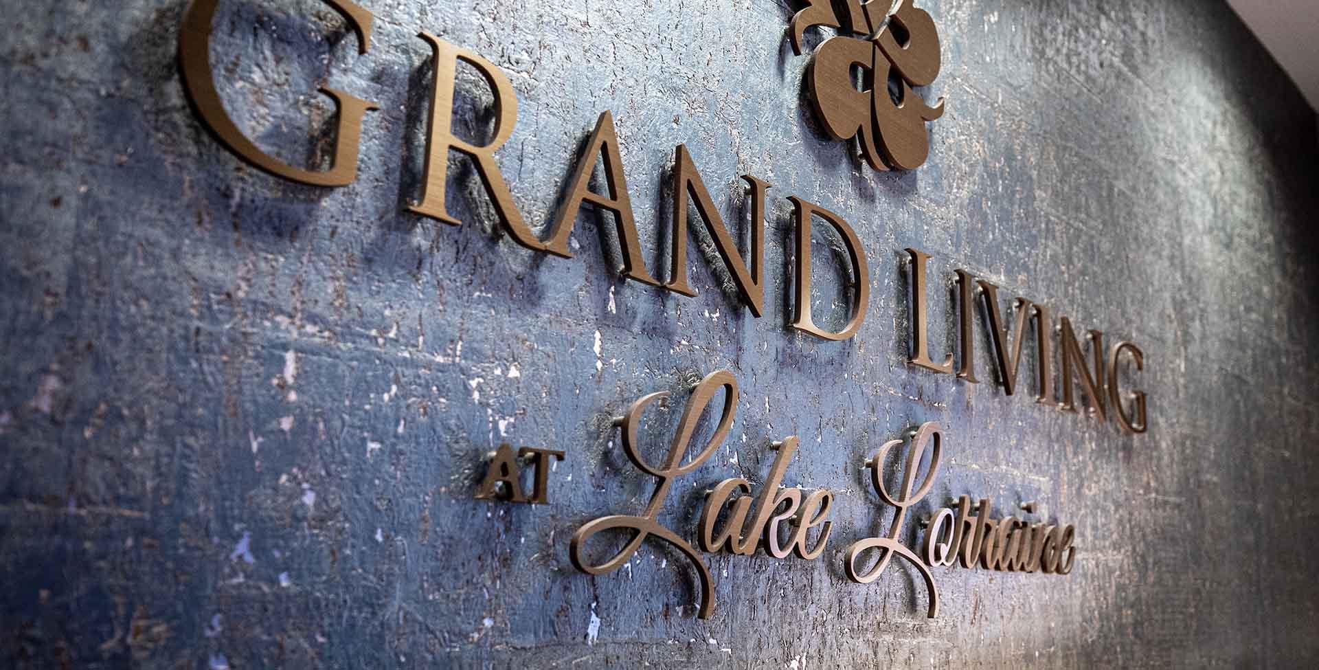 Grand Living at Lake Lorraine signage