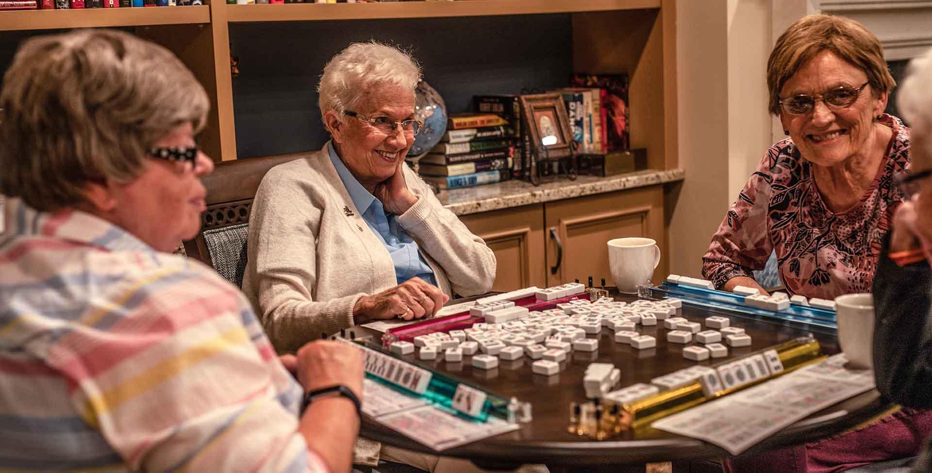three residents playing mahjong