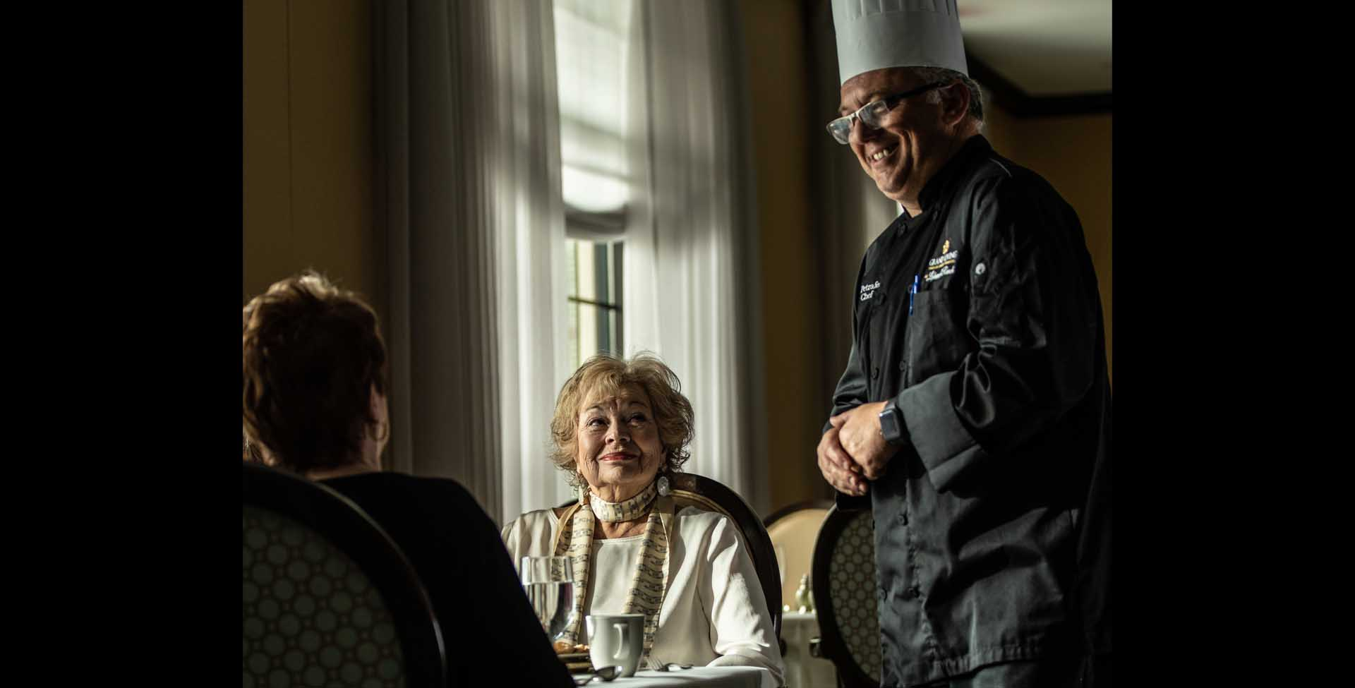 residents and executive chef interacting