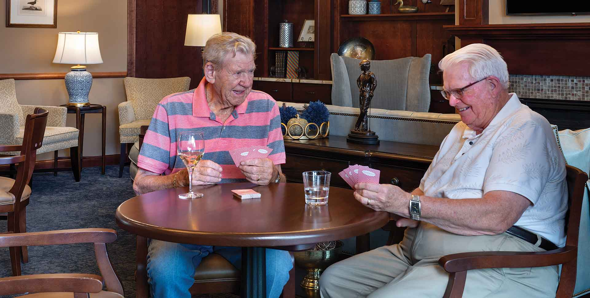 residents playing cards over drinks